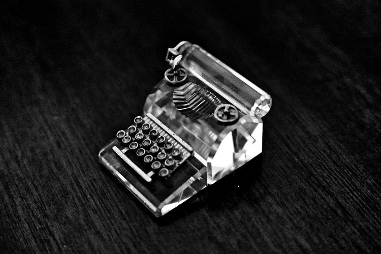 High angle view of crystal telephone on table