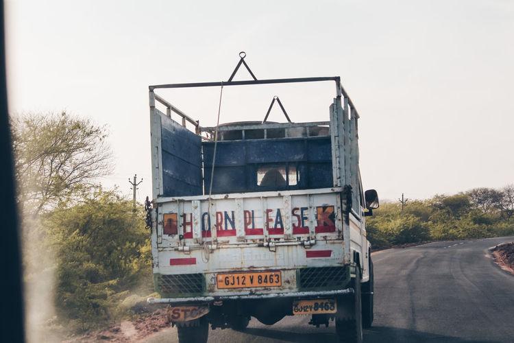 Information sign on road against sky