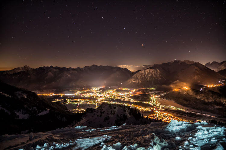 Lights of the villages from the mountains by night Night Mountain Scenics - Nature Sky Beauty In Nature Mountain Range No People Tranquil Scene Nature Winter Snow Cold Temperature Star - Space Space Illuminated Astronomy Tranquility Environment Snowcapped Mountain Outdoors Mountain Peak Long Exposure Winter Lights Alps Austria Tyrol