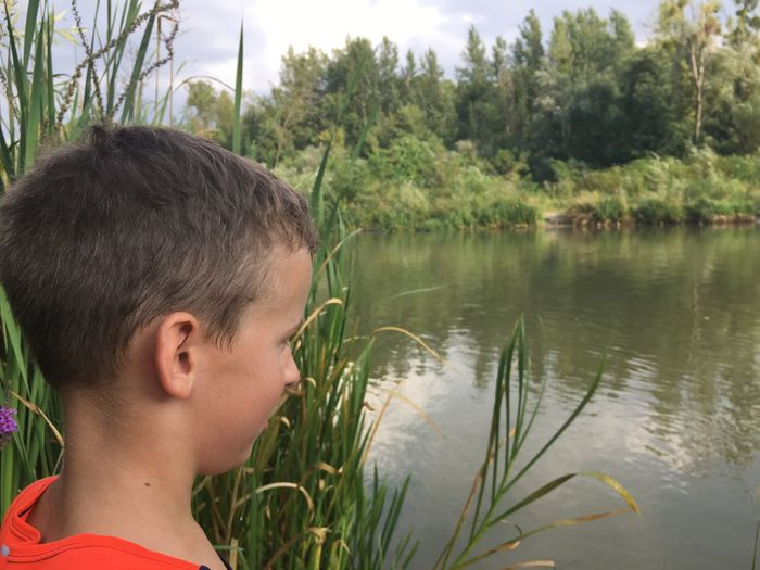 Side view of a boy at lakeside. Schoolboy portrait in nature. Casual Happiness Interesting Nature Panoramic Riverside Rural View Amazing Botanical Boy Caucasian Child Countryside Healthy Kid Lake Leisure Outdoor River Scene Scenery Scenics Vacation Water
