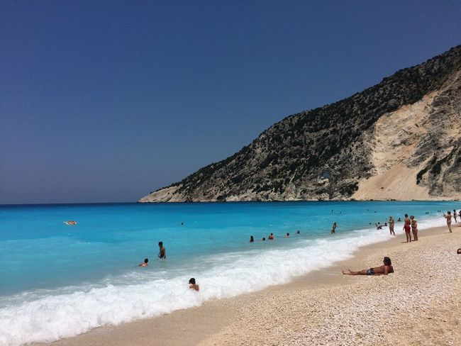 Myrtos Beach Cefalonia 2017 Beach Sea Blue Mountain Beauty In Nature Water Nature Scenics Clear Sky Sand Sky Vacations Outdoors Large Group Of People Day Summer Men Real People Horizon Over Water People Femalephotographerofthemonth 43GoldenMoments