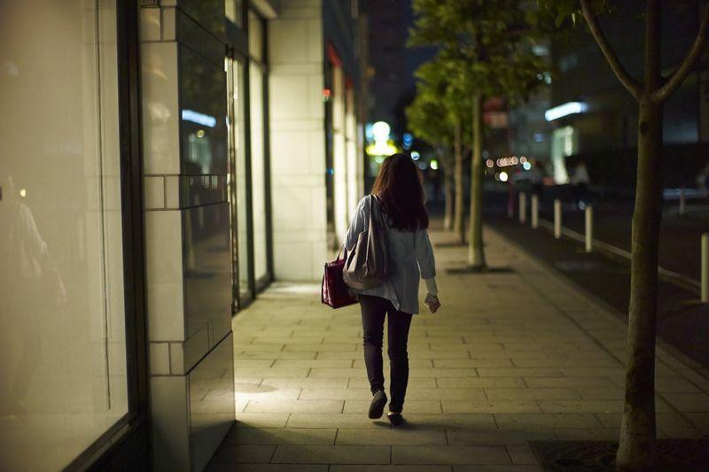 Woman on window shopping alone on street