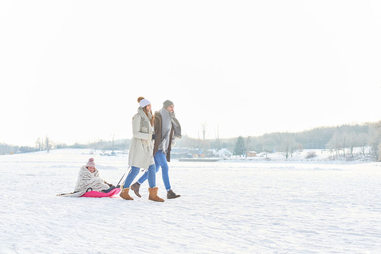 Family Adult Bonding Cold Temperature Copy Space Couple - Relationship Day Females Full Length Leisure Activity Love Men Mid Adult Nature Positive Emotion Snow Togetherness Two People Warm Clothing Winter Women