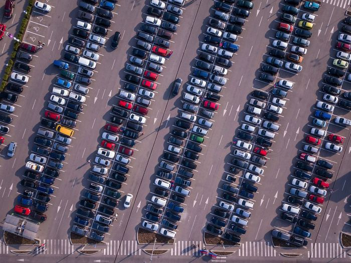 Cars line up in a parking lot Cars Diagonal Parking Lot Aerial View Apartment Architecture Backgrounds Building Building Exterior Business City Commercial Dock Container Geometric High Angle View In A Row Mode Of Transportation Motor Vehicle No People Outdoors Parking Pier Transportation Travel Water