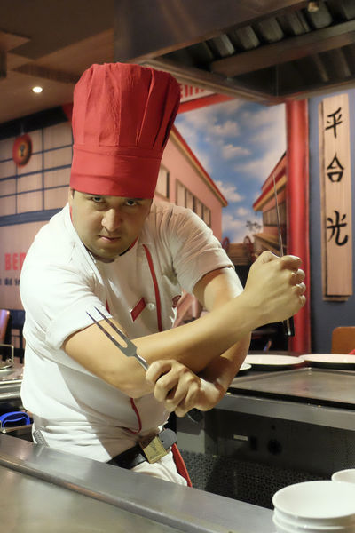 Angry Business Casual Clothing Check This Out Childhood Front View Happiness Holding Human Hand Indoors  Intense Japanese  Japanese Food Leisure Activity Lifestyles Men Occupation Person Preparation  Real People Tepanyaki Tepanyaki Chef Young Men