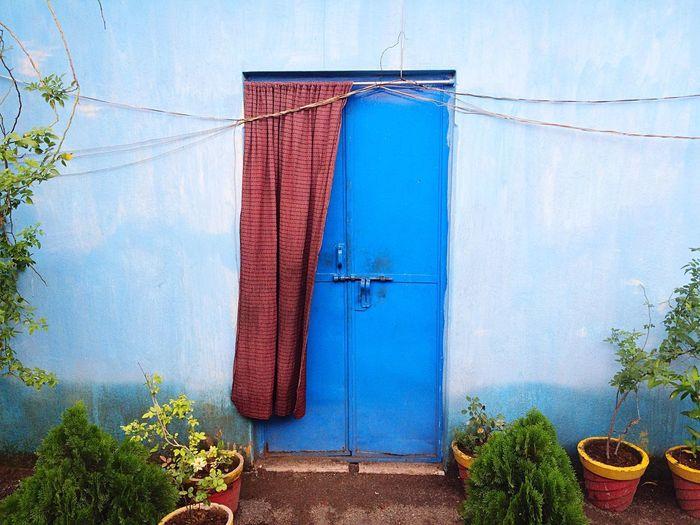 Blue door against sky