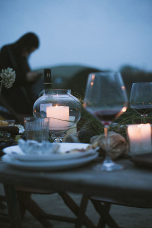 Absence Candle Celebration Crockery Dinner Drink Drinking Glass Food Food And Drink Furniture Glass Glass - Material Household Equipment Meal No People Place Setting Plate Restaurant Selective Focus Setting Table Wine Wineglass