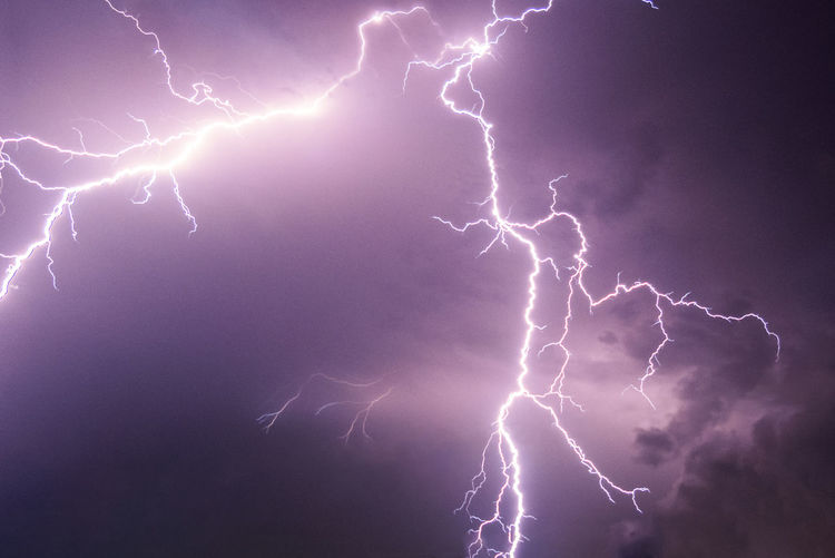 Thunderstorm Lightning Beauty In Nature Cloud - Sky Dramatic Sky Electricity  Forked Lightning Illuminated Light Lightning Low Angle View Nature Night No People Outdoors Power Power In Nature Purple Sign Sky Storm Storm Cloud Thunderstorm