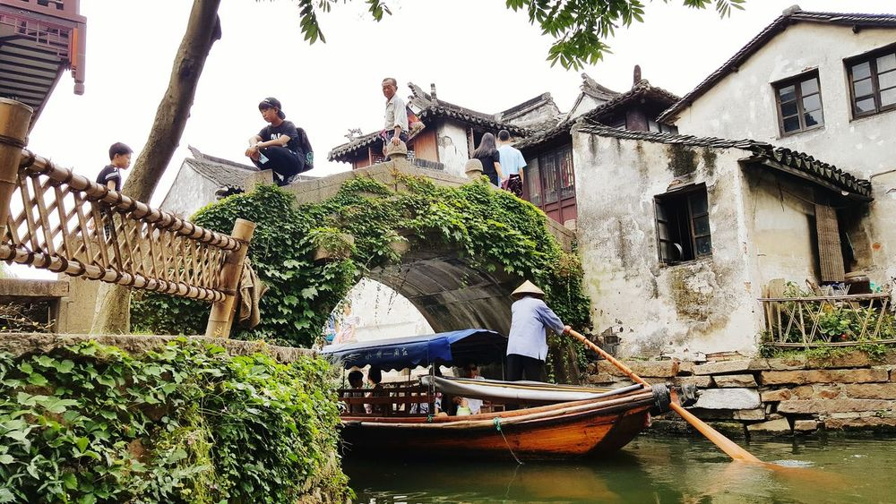 Gondola - Traditional Boat View From Below Canal Stone Bridge Historical Place Chinese Culture China Zhouzhuang On The Way Showcase July People And Places Ivy Covered Adapted To The City Miles Away EyeEm Diversity Neighborhood Map The Street Photographer - 2017 EyeEm Awards Investing In Quality Of Life Done That. An Eye For Travel Stories From The City Inner Power Adventures In The City Summer Road Tripping #urbanana: The Urban Playground