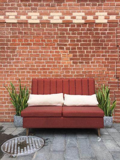 Sofa Against Brick Wall