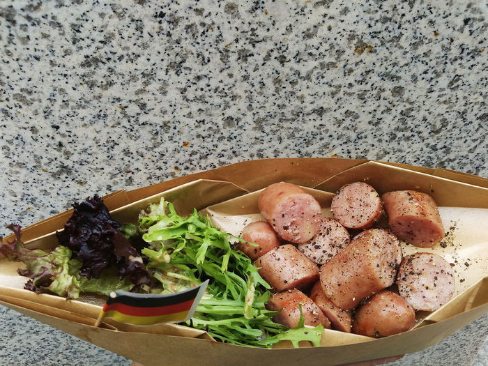 High Angle View Of Cooked Meat In Paper Bag