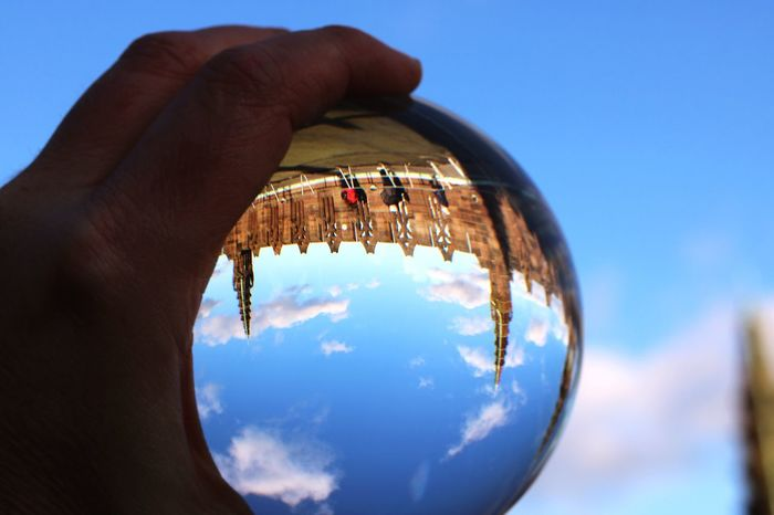 EyeEmReady Liverpool Cathedral Liverpool, England Liverpool Clouds And Sky Cloud - Sky Blue Sky People Planet Earth Clear Sky Outdoors Day Shiny Crystal Ball Blue Holding Close-up Reflection Sky One Person Real People Human Finger Human Body Part Human Hand