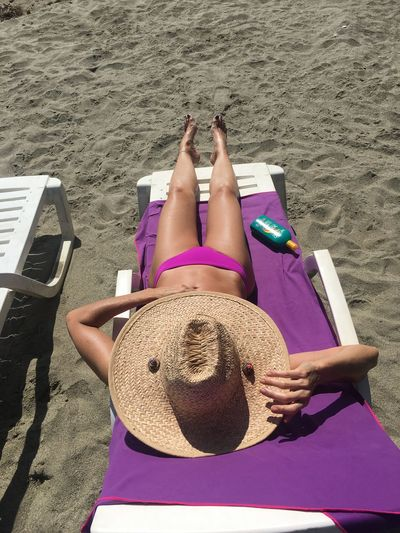 Swimsuit Fashion Land One Person Beach High Angle View Real People Relaxation Leisure Activity Holiday Vacations Sand Lying Down Trip Sunlight Summer Lifestyles Sunbathing Women Nature Clothing Day