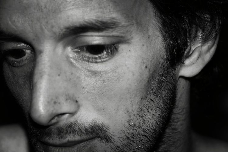 Close-Up Of Thoughtful Man In Darkroom