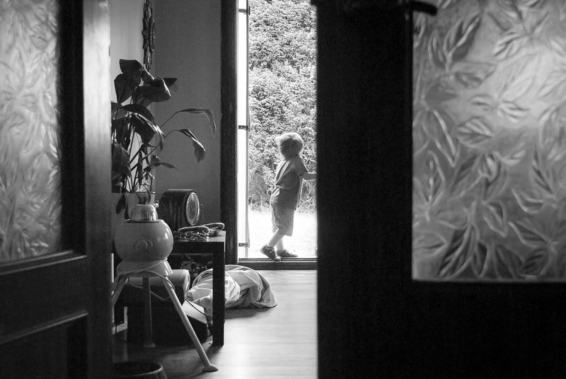 Outside there's a better world Black & White Boy Contrast Daring Day Home Interior In Or Out? Indoors  Inside Inside Out Kid Life Is Now Living Room Looking Looking For Inspiration Looking Into The Future Lookingforward Lowlight Outside Seeking Sonyalpha Threshold