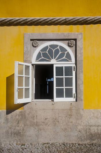 Architecture Building Exterior Built Structure Window Window Frame Window Shadow Yellow Yellow Wall
