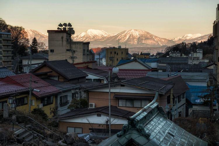Aerial view of shibu onsen town and central alps mountain at sunrise, yamanouchi, nagano, japan.