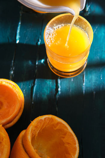 Orange juice in glass on table