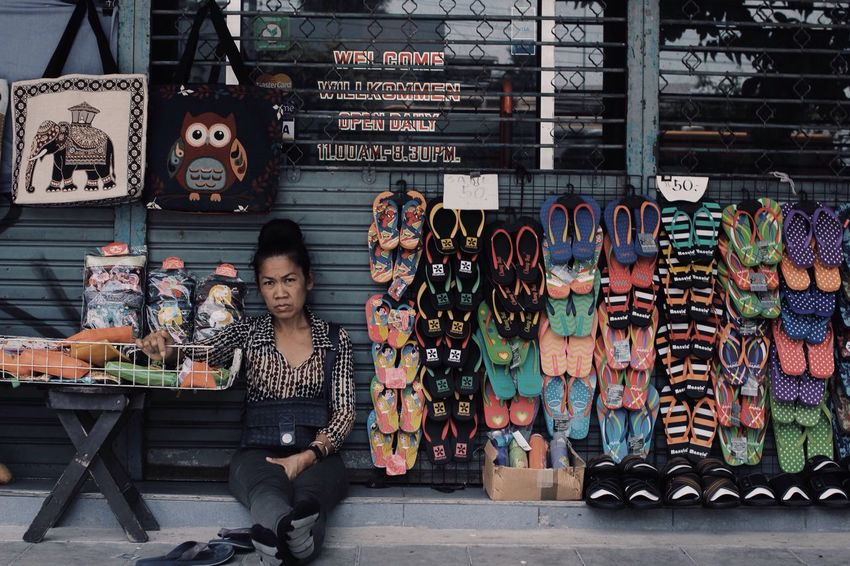 A lady selling slippers looking lil bit tired whilst waiting for customers. Bangkok Seller Tired Lady Slippers Streetphotography Streetpeople