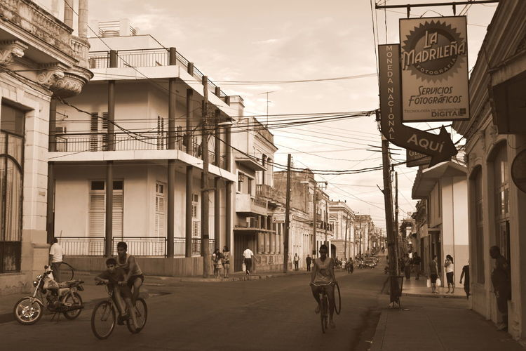 Cuba Architecture Bicicleta Bicycle Buildigs Building Exterior Built Structure Cable City Life Day Outdoors Real People Road Sepia Street Street Sign Streetphotography Transportation Urban