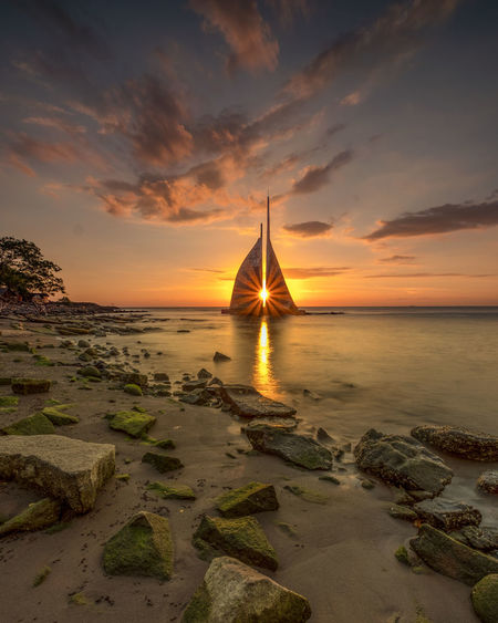 The magical star Sunset Sky Water Sea Scenics - Nature Beauty In Nature Cloud - Sky Orange Color Horizon Over Water Tranquil Scene Horizon Beach Land Nature Rock Tranquility Idyllic Non-urban Scene Makassar-Indonesia Sun