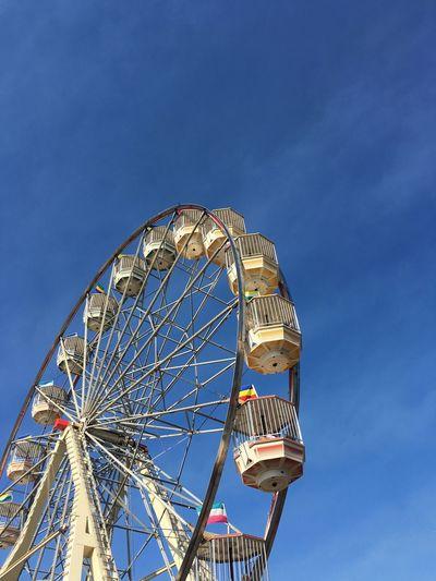 Colour Of Life Ferris Wheel Set Against Clear Blue Sky Minimalist s Show Ekka Rides fair Fair Fairground Attraction