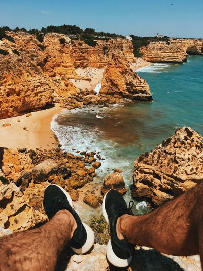 Sommergefühle Rock - Object Human Leg Low Section Water Rock Formation Personal Perspective Day Nature Shoe Men Outdoors Real People Tranquil Scene Beauty In Nature One Person Tranquility Scenics Sea Human Body Part Cliff Portugal Algarve Second Acts An Eye For Travel