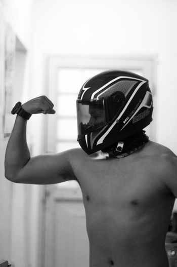 Athlete Boxing Glove Close-up Day Focus On Foreground Headwear Indoors  Leisure Activity Lifestyles Men One Person People Real People Shirtless Sport Sports Clothing Standing Strength Young Adult