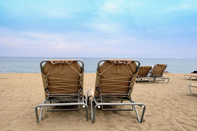 Liegestuhl Urlaub Weite Strand Erholung Relaxing Strand Water Chair Sea Horizon Over Water Sky Land Beach Horizon Absence Seat Nature Tranquility Sand Vacations Trip Holiday Scenics - Nature Tranquil Scene Day No People Outdoors Outdoor Chair