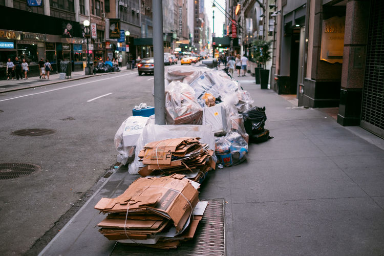City Street Architecture Incidental People Built Structure Building Exterior Bag Footpath Transportation Garbage Stack Day Plastic Large Group Of Objects Sidewalk Environmental Issues Abundance Road Plastic Bag Dirty Messy Pollution