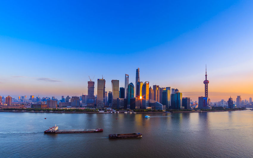 City Skyline By The Bank Of Huangpu River During Sunset