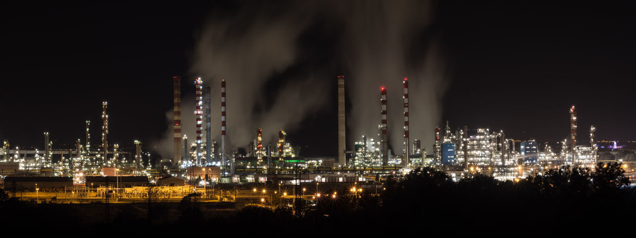Night panorama of refinery plant. Air Pollution Architecture Building Exterior Built Structure City Cityscape Cooling Tower Environment Factory Fuel And Power Generation Illuminated Industry Nature Night No People Office Building Exterior Oil Industry Oil Refinery Outdoors Pollution Refinery Sky Skyscraper Smoke - Physical Structure Smoke Stack