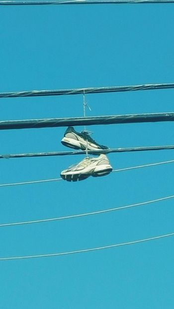 In keeping with the sky theme Hangingshoes Sky Bluesky Shoes Powerlines Houston Texas TwoIsBetterThanOne
