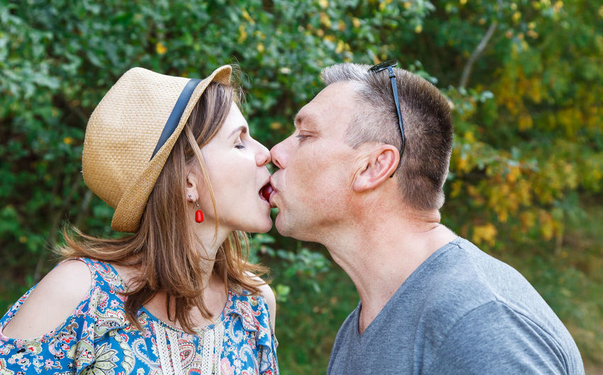 Portrait of couple kissing outdoors
