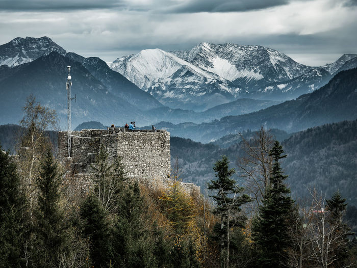 castle with alps in the background Adventure Atmosphere EyeEmNewHere Eyeemphotography Eye Em Nature Lover Landscape Outdoors Tourism People Alps Castle Tower Forest Nature Tree Mountain Snow Winter Cold Temperature Pine Tree Pinaceae Sky Mountain Range Landscape Snowcapped Mountain Woods