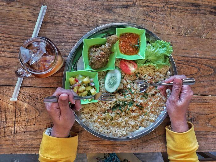 High angle view of man having food