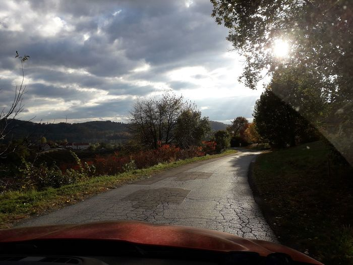 on the road again,i love to travel❣❣❣ Drivingshots Steiermark,Austria Mood Captures Beauty In Nature Beautiful Light Simple Beauty Simple Photography For My Friends 😍😘🎁 Lucky Me🦄 Happy Moment♥ Thankful🦄 Life Is Motion In Motion, Sunny Day Autuum In Austria🤩 Tree Road Land Vehicle Car Windshield Sunlight Sky Cloud - Sky