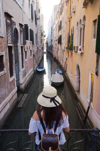 Architecture Building Exterior Built Structure Canal Casual Clothing City Day Gondola - Traditional Boat Leisure Activity Lifestyles Nautical Vessel One Person Outdoors People Real People Rear View Transportation Water Women