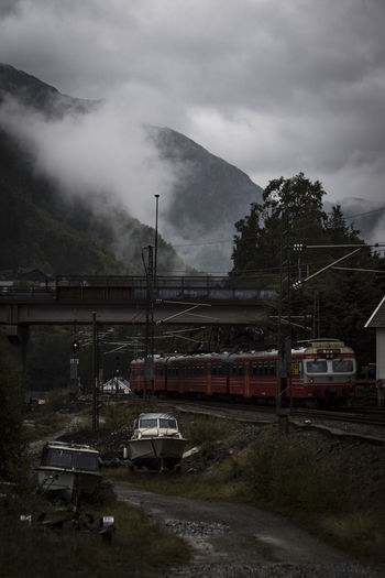Train on mountain against sky