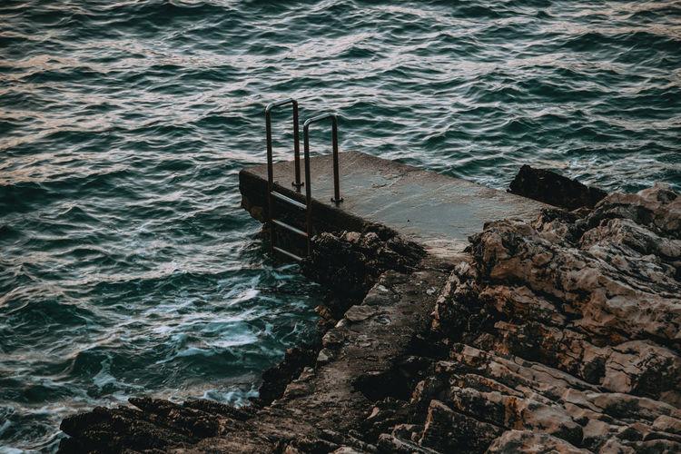High angle view of rocks at sea shore