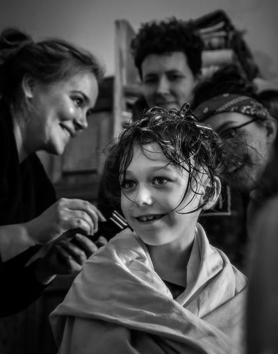 Portrait of a boy, who is having hair cut