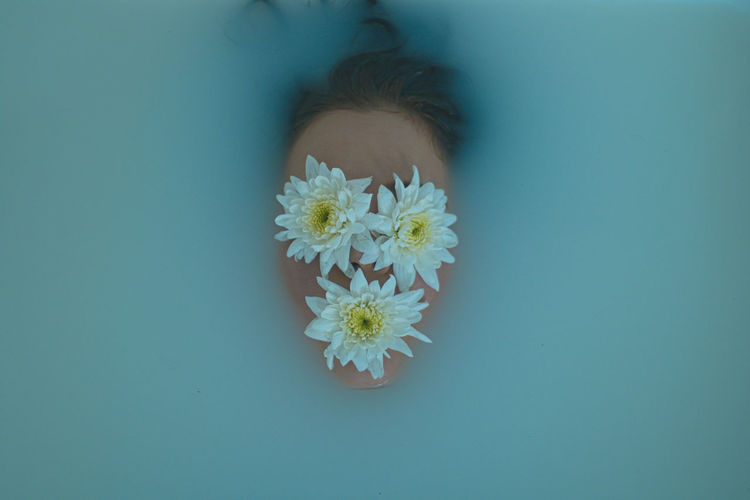 Close-up of flowers on face in water