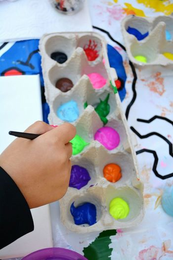 Child's hand painting with colors in egg carton Artistic Expression Child Painting Art In Progress Lifestyle Photography Colorful Colors Hands At Work Hand