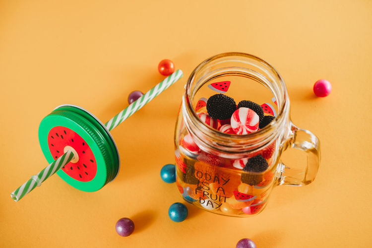High angle view of candies in glass jar on table