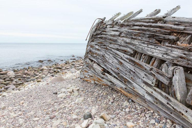 Old shipwreck on a sea shore