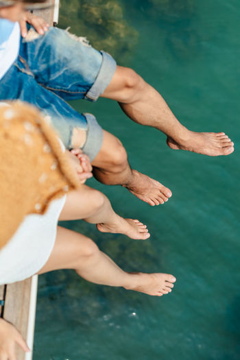 Midsection of couple in water