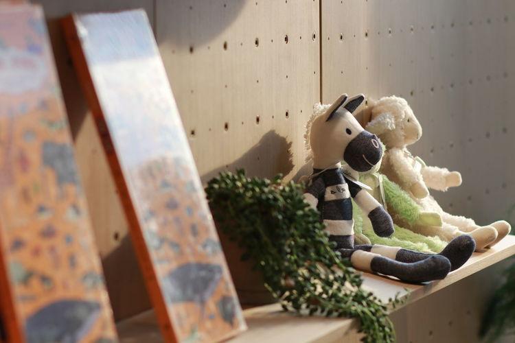Close-up of toys on shelf