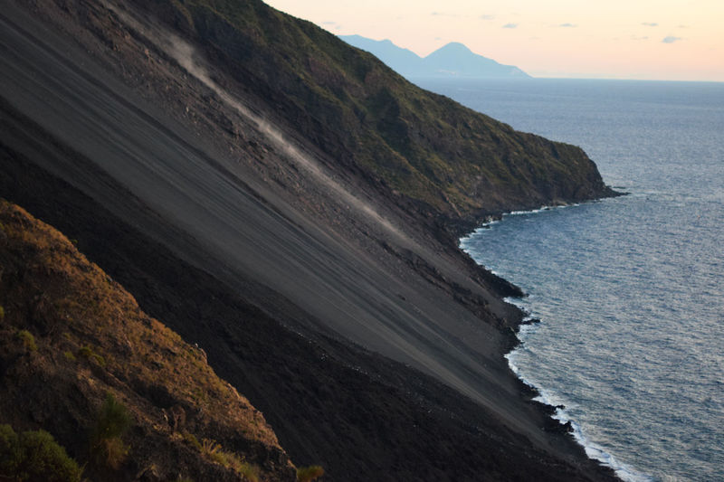 Scenic view of stromboli steep in sea