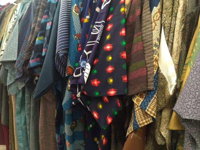 Panoramic shot of clothes hanging on display for sale