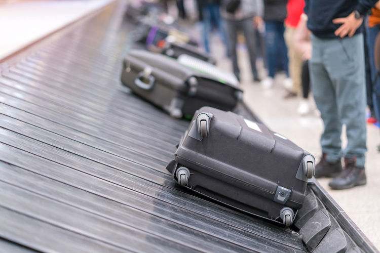 Luggage on baggage claim at airport